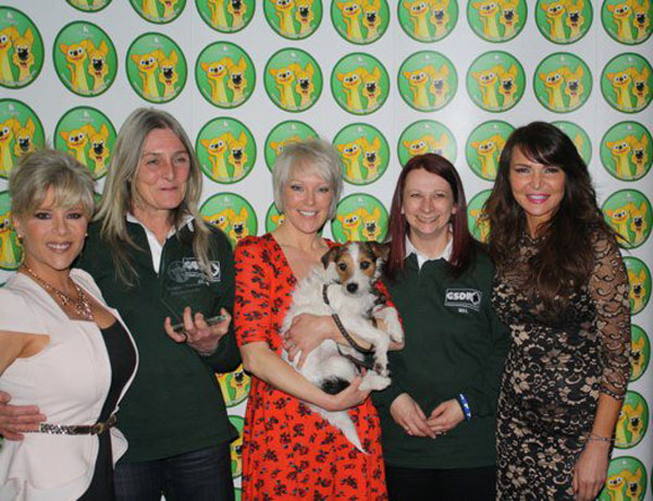 Sam Fox, Helen Chamberlain, Lizzie Cundy present the award to Mel and Jayne from GSDR